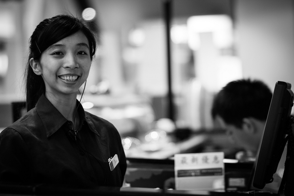 Sharon does a bunch of things at the sushi place - taking orders, payments, coordinating the staff. She worked at another restaurant before this but changed jobs because the earlier place had too many rules.