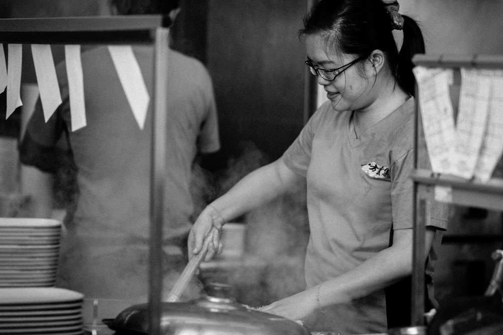 Miss Chung has been working here for only a few months. She learnt how to make dumplings by simply watching how others were doing it.